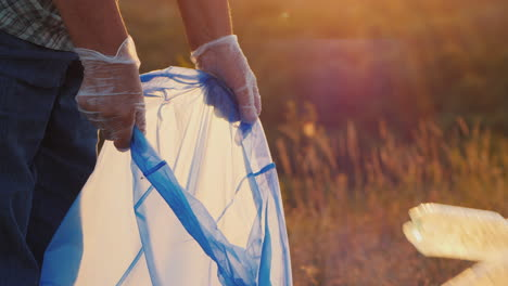 Volunteers-Put-Trash-In-Plastic-Bags-Cleaning-The-Park-And-Caring-For-The-Environment-Close-Up-Shot