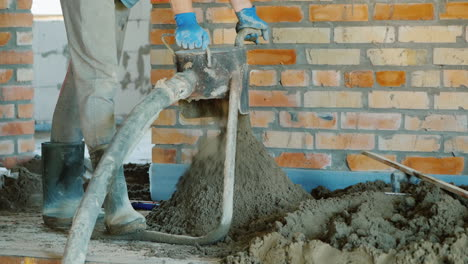 The-Builder-Puts-A-Semi-Dry-Mortar-For-Finishing-The-Floor