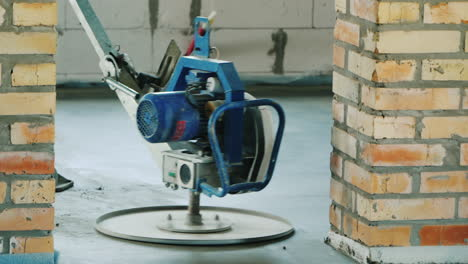 A-Worker-With-A-Power-Tool-Will-Cover-A-Concrete-Stitch-On-The-Floor