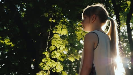The-Child-Stands-In-The-Beam-The-Sun-Is-Shining-On-Her-Face-Get-Lost-In-A-Fairy-Forest