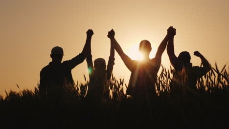 A-Group-Of-Successful-Young-People-Hold-Hands-Together-They-Raise-Their-Upper-Hand-Successful-Team-A