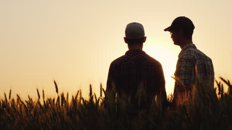 Two-Young-Men-Hugging-Against-The-Backdrop-Of-The-Sunset-Looking-Forward-To-The-Horizon