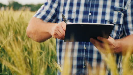 The-Farmer-Signs-The-Document-And-Shakes-Hands-With-A-Partner-On-The-Background-Of-A-Wheat-Field