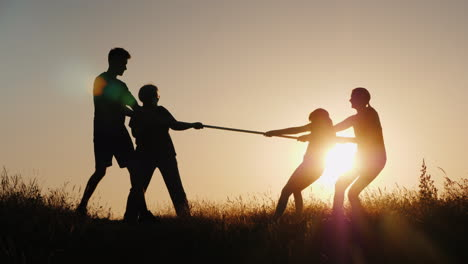 Children-And-Adults-Compete-In-Tug-Of-War-A-Healthy-And-Active-Lifestyle