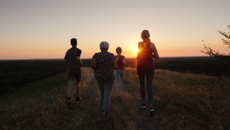 A-Friendly-Family-Of-Four-Jogs-Together-Grandmother-Mom-With-Dad-And-Baby