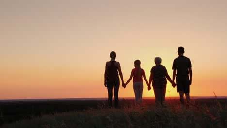 Active-Healthy-Family-Grandmother-With-Daughter-And-Grandchildren-Meet-The-Dawn-Raise-Their-Arms-Abo