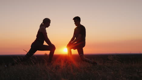 Mom-And-Her-Adult-Son-Play-Sports-Together-In-A-Beautiful-Sunset-Setting