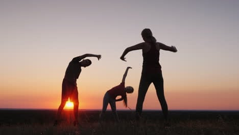 Family-With-A-Child-Does-Exercises-In-Nature-In-A-Picturesque-Place