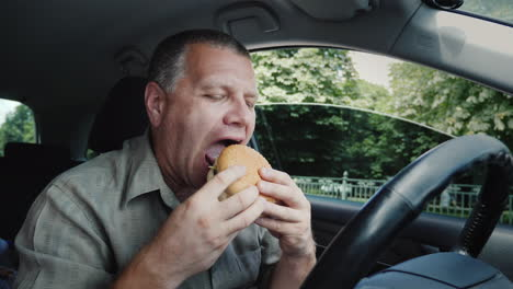 The-Driver-Eats-Fast-Food-Inside-The-Car
