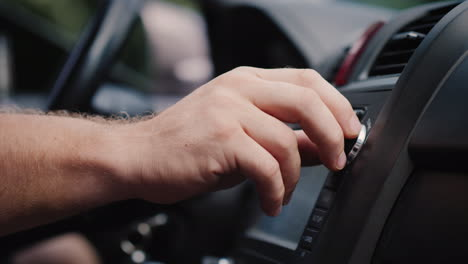 Male-Hand-Adjusts-The-Tuning-Of-The-Car-Radio-Close-Up-Shot