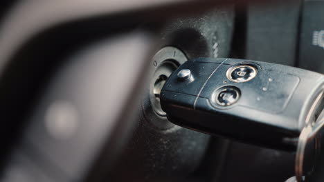 Start-The-Car-Passenger-Car-Hand-Inserts-The-Ignition-Key-Close-Up-Shot