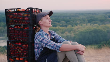 Woman-Farmer-Resting-After-Work-Sitting-Near-Boxes-With-Tomatoes