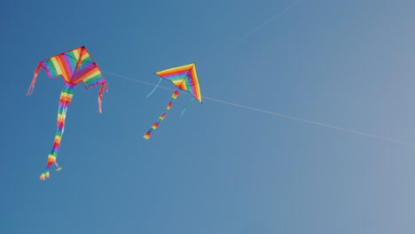 Two-Kites-Soar-Nearby-High-In-The-Sky-Synchronization-And-Precise-Control-Concept