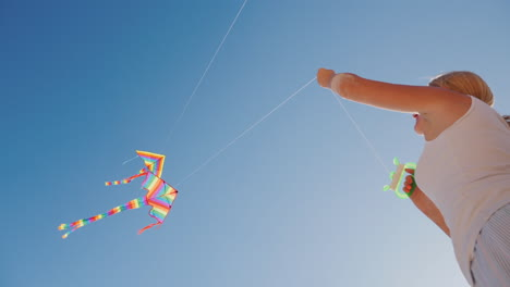 Active-Rest-On-The-Beach---Woman-Playing-With-Kite-Bottom-View