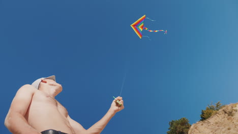 A-Man-Is-Trying-To-Fly-A-Kite-There-Is-Not-Enough-Wind-For-A-Good-Rope-Tension
