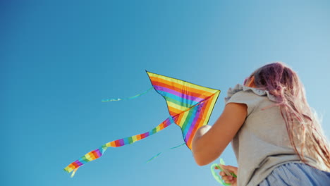 Young-Woman-Playing-With-Kite-Bottom-View