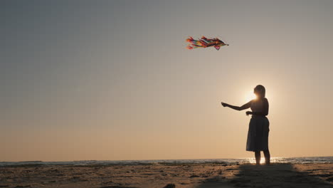 Side-View---Silhouette-Of-A-Young-Woman-With-A-Kite
