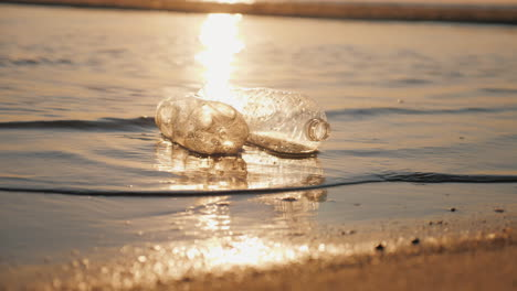 Two-Plastic-Bottles-Float-In-The-Water-Near-The-Shore-Plastic-Pollution-Concept