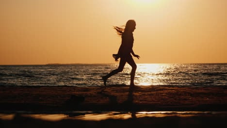 Silhouette-Of-A-Carefree-Child-Running-Along-The-Beach