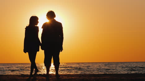 An-Elderly-Woman-Stands-Next-To-Her-Granddaughter-At-Sunset-Active-Seniors