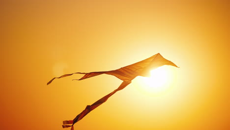 A-Kite-Flies-In-The-Rays-Of-The-Setting-Sun-Childhood-And-Dreams-Concept