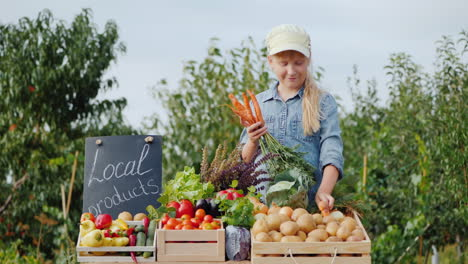 Little-Farmer-Girl-At-The-Counter-With-Vegetables