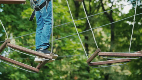 The-Boy-Is-Stuck-On-A-Rope-Obstacle-Can-Not-Make-A-Step-Overcome-The-Fear-Concept
