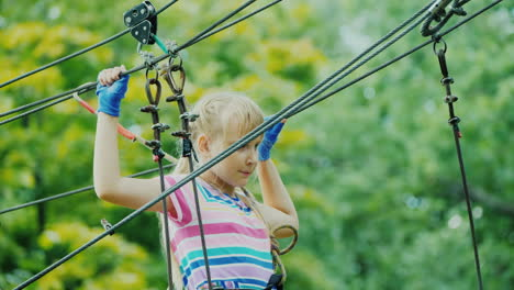 Entertainment-In-Summer-Camp---A-Child-Learns-To-Use-Insurance-Cables-Climbs-High-In-The-Branches-Of