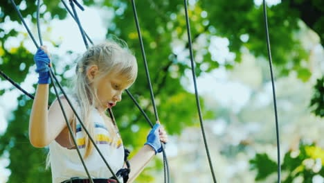 A-Brave-Child-Walks-Along-A-Tightrope-Between-Tall-Trees-Active-Childhood-And-Fun