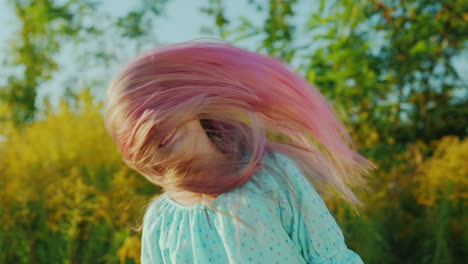 Cool-Girl-Playing-With-Her-Pink-Long-Hair