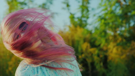 Carefree-Girl-In-Sunglasses-With-Pink-Hair-Waving-Her-Head