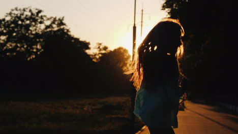 Silhouette-Of-A-Girl-Having-Fun-Running-Down-The-Alley-In-The-Rays-Of-The-Setting-Sun