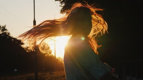 A-Child-Frolics-On-The-Street-In-The-Evening-When-The-Sun-Sets-Runs-And-Jumps-Emotionally