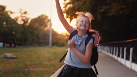 Cheerful-Child-With-A-Satchel-Behind-His-Back-Runs-Towards-The-Camera-Back-To-School