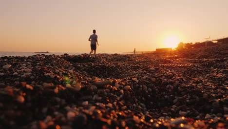 Silhouette-Of-A-Man-Jogging-Near-The-Sea-At-Sunset