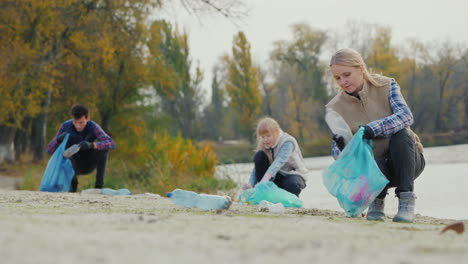 The-Family-Collects-Plastic-Trash-On-The-Lake-Clean-Environment-Concept