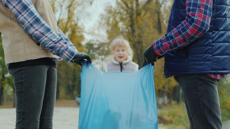 Portrait-Of-A-Volunteer-Child-Collecting-Trash-In-A-Park