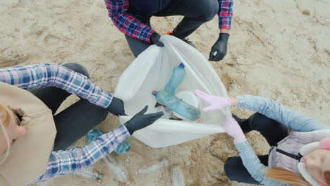 Volunteers-Put-Garbage-Collected-On-The-Beach-In-A-Package-View-From-Above