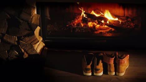 Men-s-And-Women-s-Winter-Boots-Dry-Near-The-Fireplace-Romantic-Winter-Evening
