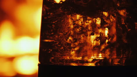 Boiling-Water-In-A-Clear-Glassware-On-A-Background-Of-Open-Fire-In-A-Fireplace