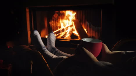 Relax-With-A-Cup-Of-Tea-By-The-Fireplace-Winter-Escape-From-All-Problems
