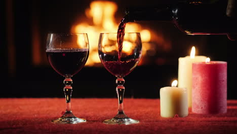The-Waiter-Pours-Wine-Into-The-Glasses-In-The-Background-A-Fire-Burns-In-The-Fireplace