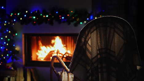 A-Rocking-Chair-Stands-In-Front-Of-A-Fireplace-Decorated-For-Christmas-And-New-Year-4k-Video