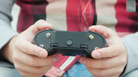 Male-Hands-With-A-Drone-Control-Panel-Precise-Control