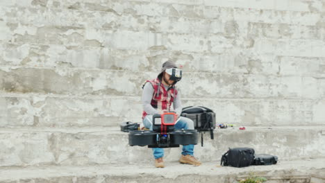 A-Man-Pilots-A-Drone-In-A-Helmet-With-A-Video-Screen-First-Person-Sports-Piloting