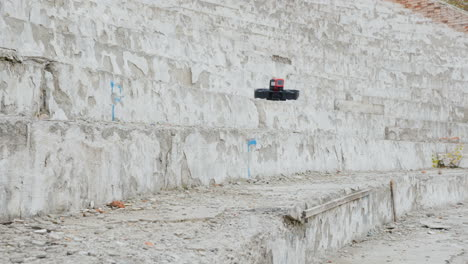 Drones-Racing---Aircraft-Flying-Low-Over-Concrete-Steps