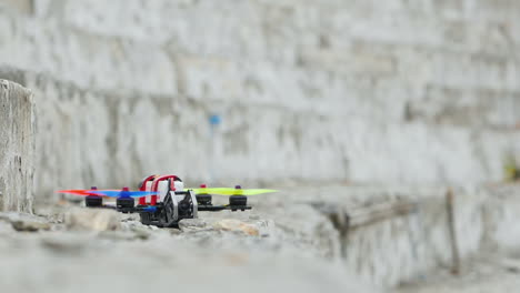 Racing-Drone-Takes-Off-From-Concrete-Steps