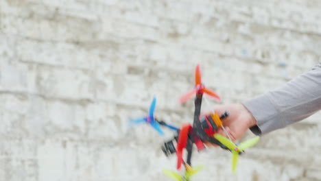 Hand-Throws-A-Little-Racing-Drone-Hobbies-And-Entertainment