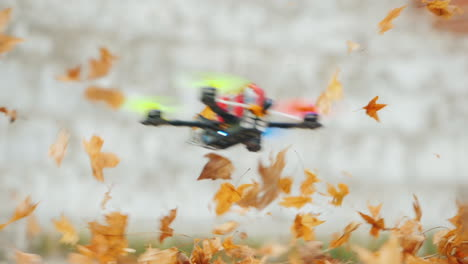 The-Quadcopter-Flies-Low-Above-The-Ground-Effectively-Lifting-The-Fallen-Leaves-Into-The-Air