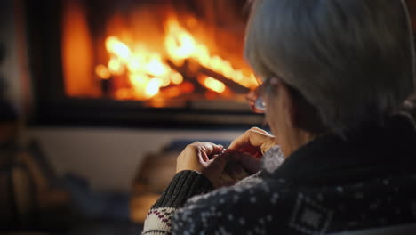 Elderly-Lady-Knits-A-Warm-Scarf-By-The-Fireplace